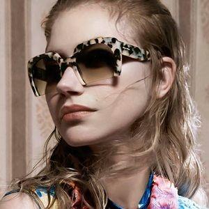 Miu Miu Sunglasses Tortoiseshell SMU06Q